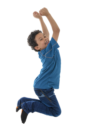 Young Active Boy Jumping in The Air Isolated on White Background