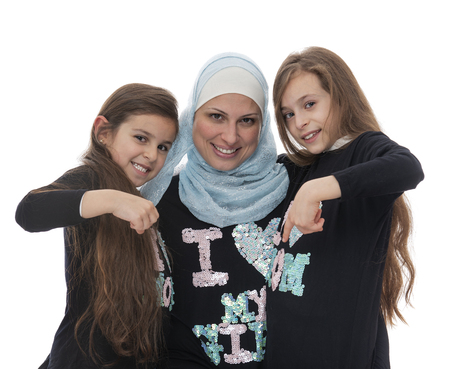 Happy Muslim Mother and Her Daughters Happy Muslim Mother and Her Daughter Loving Each Other Isolated on White Background