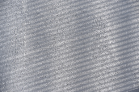 Abstract Background of Shadow Lines over White Cement Wall 版權商用圖片