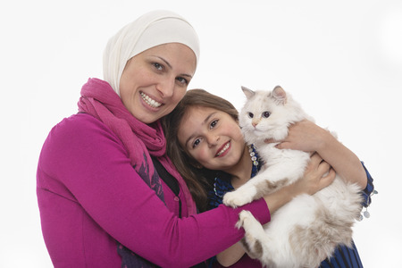 Happy Muslim Mother & Girl and A White Cat Isolated on White