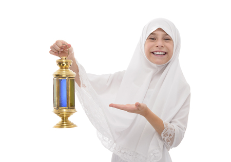 Happy Muslim Girl in White Veil Smiling Celebrating Ramadan with Festive Lantern, Isolated on White