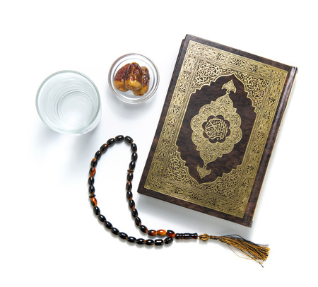 Ramadan Items, Quran Holy Book, Water, Dates and Rosary, Isolated on White Table
