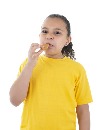 A Girl Expressing Disgust, Bad Food Taste, Isolated on White