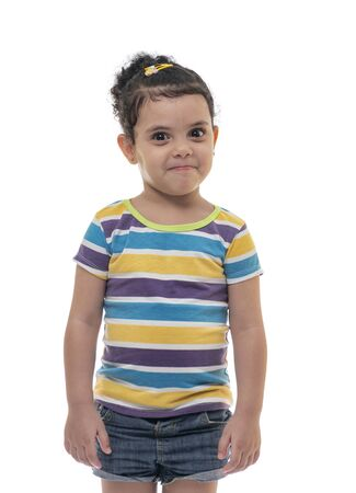 A Cute Little Girl with A Angry Smile, with Warning Face, Looking with A Threatening Look Archivio Fotografico - 133244065