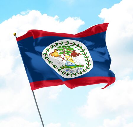 National Flag of Belize Raised Up with Sky and Clouds in Background