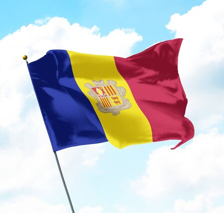 National Flag of Andorra Raised Up with Sky and Clouds in Background