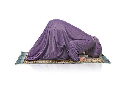 Beautiful Arabic Muslim Girl Praying Wearing Prayer Clothes Isolated on White Background, Kneeling