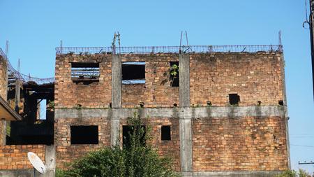 unfinished building: Abandoned brick building
