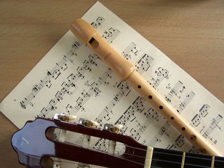 guitar and flute with sheet music photo