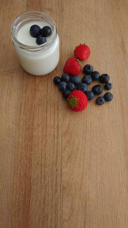 Glass Jar with White Yogurt and Fresh Berries