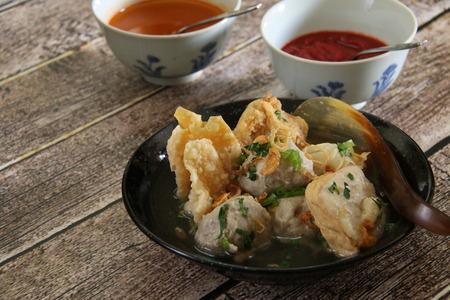 Bakwan Malang  Surabaya. East Javanese comfort food of meatballs, wontons, and bean curd in hot beef broth. Served with chili sauce on side.
