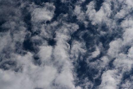 menacing: Dark blue sky with nice clouds purl, something menacing