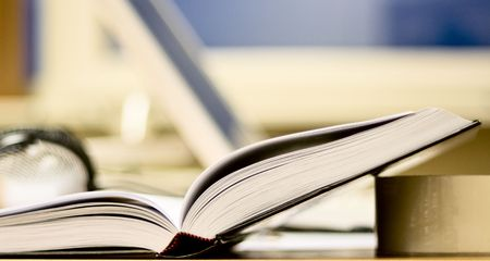 twining: Open book on office table. Place for work and self-education