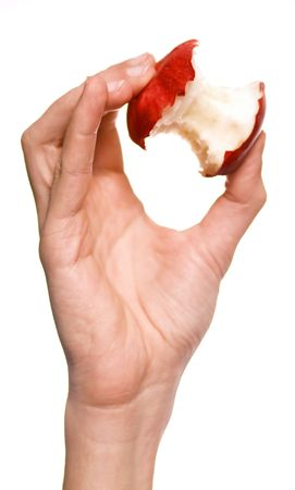 Mans hand holding an apple core isolated on white background photo