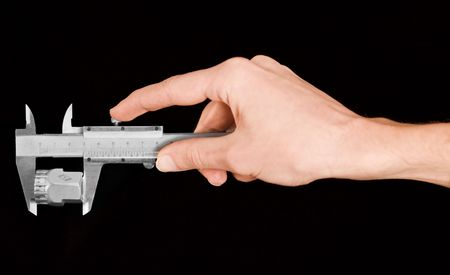 Hand of a man measuring with caliper isolated on black background Stock Photo - 6229879