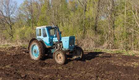 plowing: Tractor plowing Stock Photo