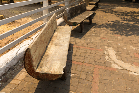 timber bench seat: few wooden benches standing in the park Stock Photo