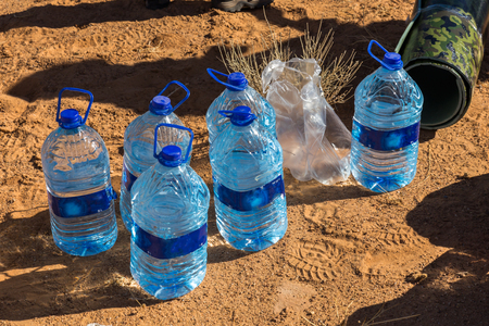 litre: 5 litre bottles of water on the sand