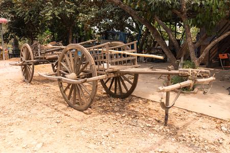 bullock animal: Traditional antique horse drawn wooden cart, cambodia
