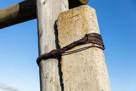mains: Old wooden poles - the line of electricity transmissions