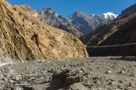 suspension bridge across mountain river, Himalayas Nepal