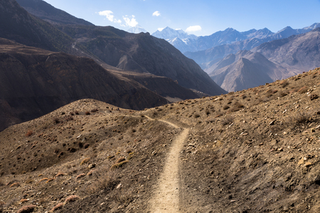 mountain trail in the Himalayas, Mustang Nepal Stock Photo