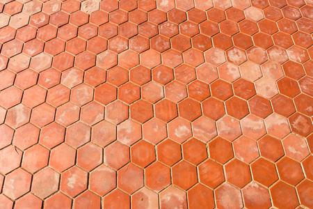 Closeup of Cement floor in hexagonal clay tiles Stock Photo