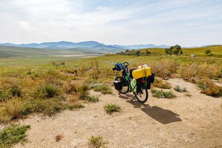 travelers bike with bags, landscape in mongolia, Bike adventure travel, tourist bike