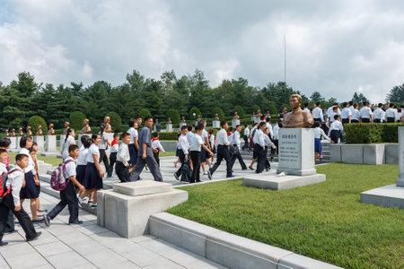 Pyongyang,North Korea-July 27, 2014: Korean students at the memorial cemetery of revolutionaries in Pyongyang. Editorial