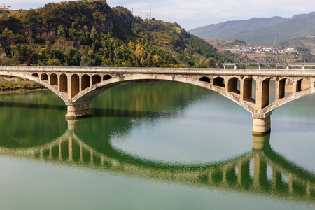ancient stone bridge over the Bailong River, China. Stock Photo