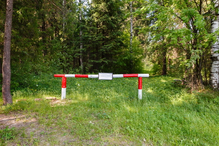 barrier in the forrest. The ban on entry into the forest.