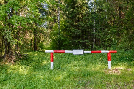 barrier on the forest road. The ban on entry into the forest.