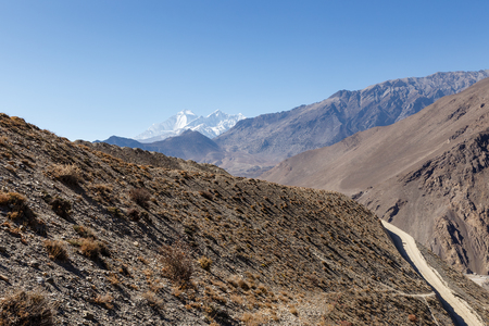 Mountain landscape Nepal, mountain road, Mount Dhaulagiri and Tukuche Peak