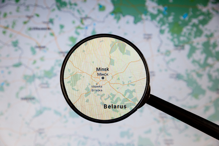 Minsk, Belarus. Political map. City visualization illustrative concept on display screen through magnifying glass.