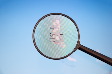 Moroni, Comoros. Political map. City visualization illustrative concept on display screen through magnifying glass. Stockfoto