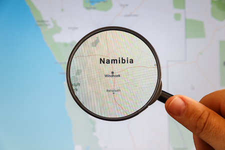 Windhoek, Namibia. Political map. City visualization illustrative concept on display screen through magnifying glass in the hand.