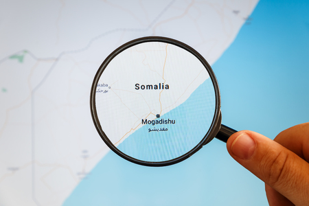 Mogadishu, Somalia. Political map. City visualization illustrative concept on display screen through magnifying glass in the hand.