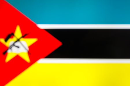 abstract blurred background color of the national flag of Mozambique, Patriotic background