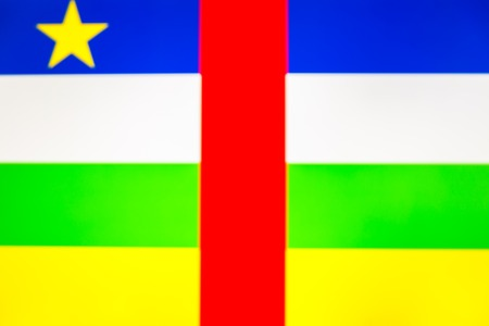abstract blurred background color of the national flag of Central African Republic, Patriotic background Фото со стока