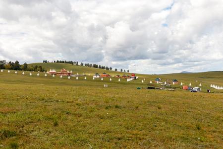 Buddhist monastery, Stupas along the wall of a Mongolian monastery, Bornuur, Mongolia.