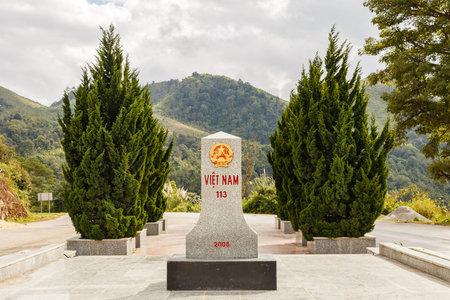 Tay Trang, Dien Bien, Vietnam - November 25, 2018: Border sign denoting the border between Vietnam and Laos. View from Vietnam.