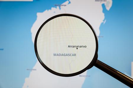 Antananarivo, Madagascar. Political map. The city on the monitor screen through a magnifying glass.