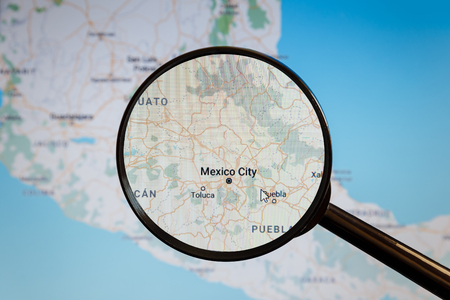 Mexico City, Mexico. Political map. The city on the monitor screen through a magnifying glass.