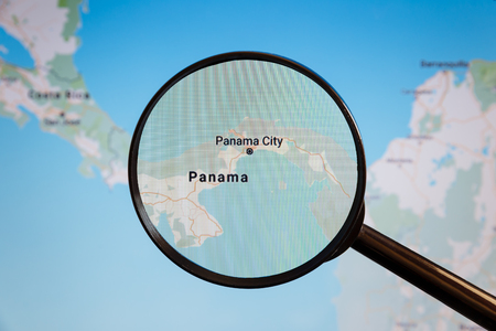 Panama City, Panama. Political map. The city on the monitor screen through a magnifying glass.