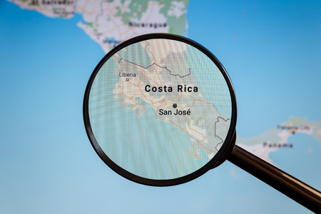 San Jose, Costa Rica. Political map. The city on the monitor screen through a magnifying glass.