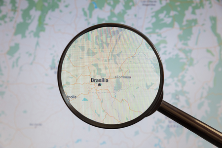 Brasilia, Brazil. Political map. The city on the monitor screen through a magnifying glass
