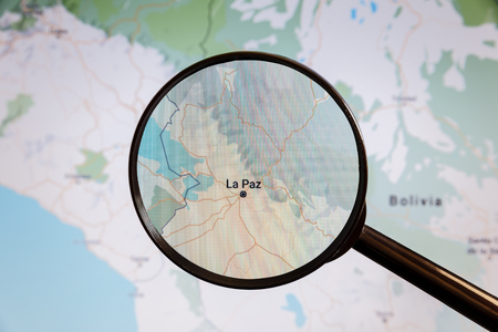 La Paz, Bolivia. Political map. The city on the monitor screen through a magnifying glass