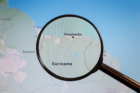Paramaribo, Suriname. Political map. The city on the monitor screen through a magnifying glass. Stockfoto