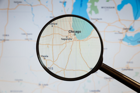 Chicago, United States. Political map. The city on the monitor screen through a magnifying glass.