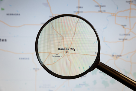 Kansas City, United States. Political map. The city on the monitor screen through a magnifying glass.